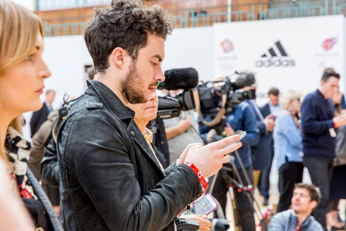 corporate-events-Stella-McCartney-Sports-Wear-Launch-for-Adidas young boy with a phone Belle Imaging Event Photographer London