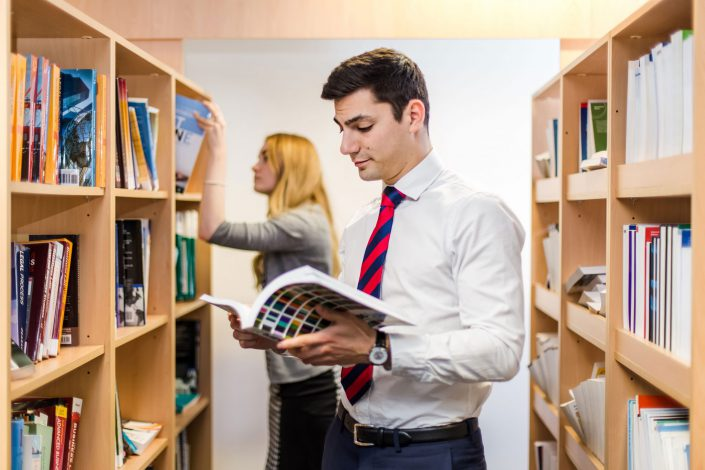 Students browsing in a library Anglia Ruskin University Belle Imaging by Renata Boruch Commercial Photographer London