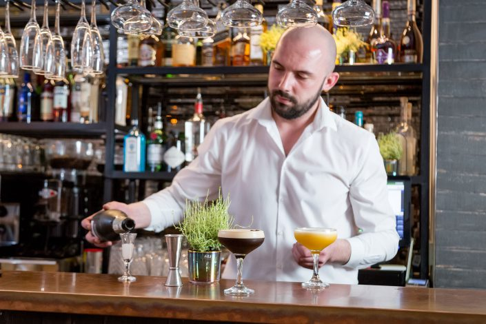 Bartender preparing drinks, Restaurant photography by Renata Boruch at Belle Imaging, Commercial Photographer London