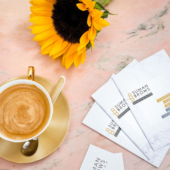 Still Life style shot of a coffee cup and a brochure, Suman Brows Instagram Project, Product Photographer London, Belle Imaging