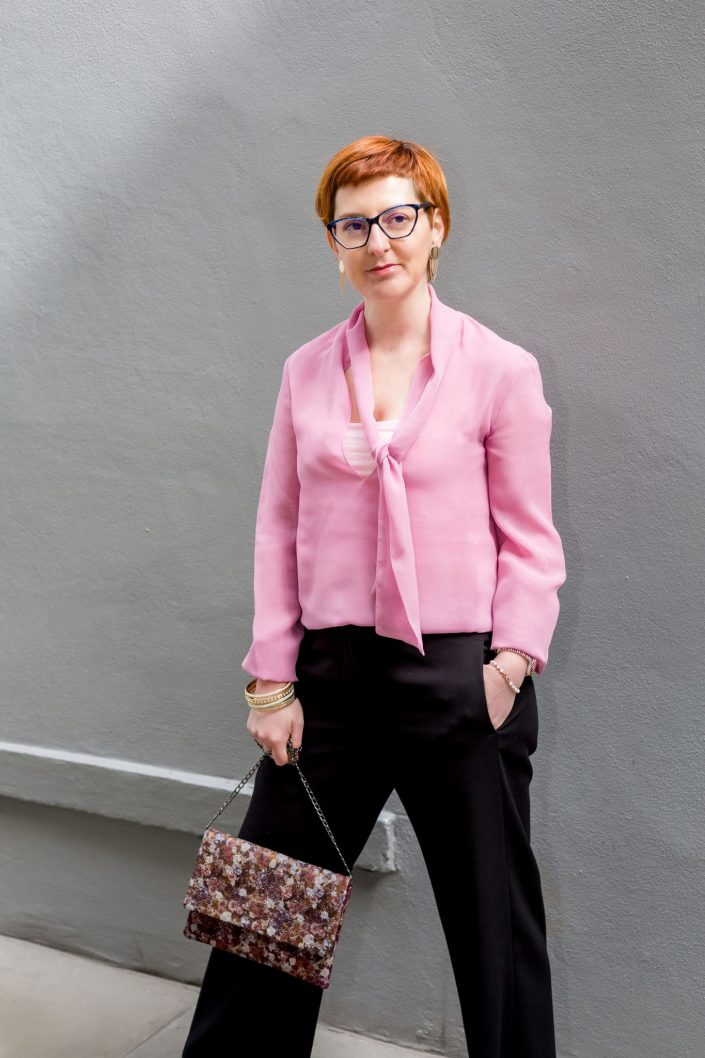 Portrait of a woman in a pink blouse by Belle Imaging Photography